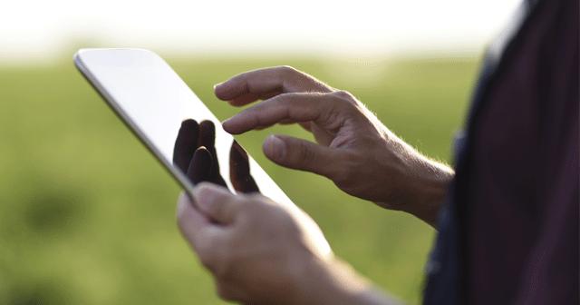 Blog header Farmer using tablet