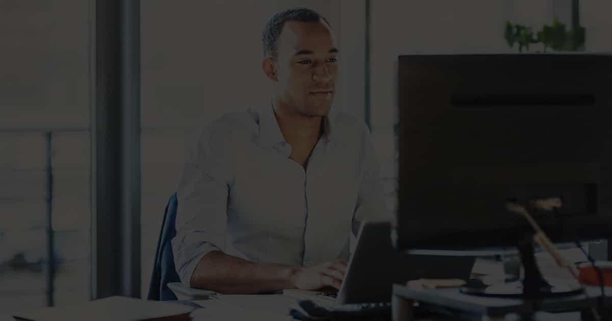 Man behind desk on computer