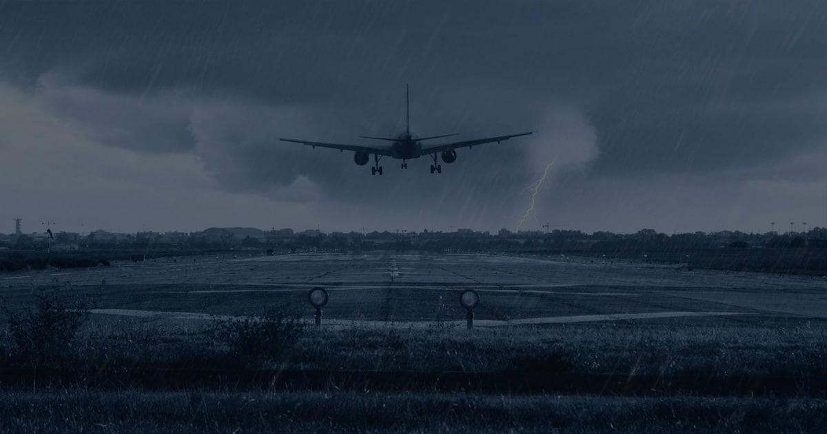 Features Airplane landing in rainstorm