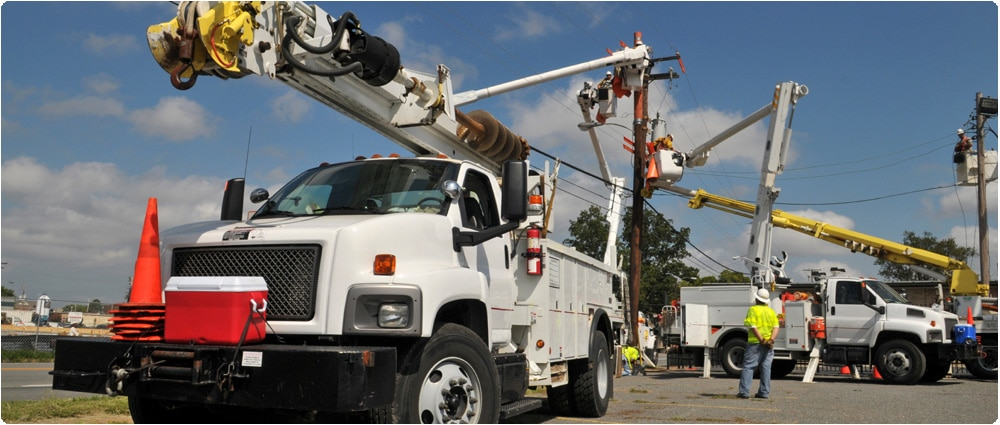 Electrical company truck by power lines