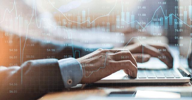 Blog Header Hands on Laptop with Market Data