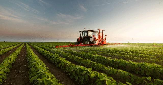 Blog Header Tractor Spraying in Field