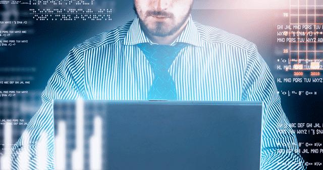 Blog Header Businessman at laptop with data background