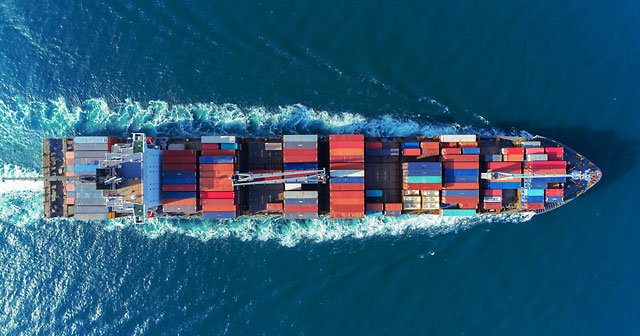 Aerial view Top speed with beautiful wave of container ship full load container.