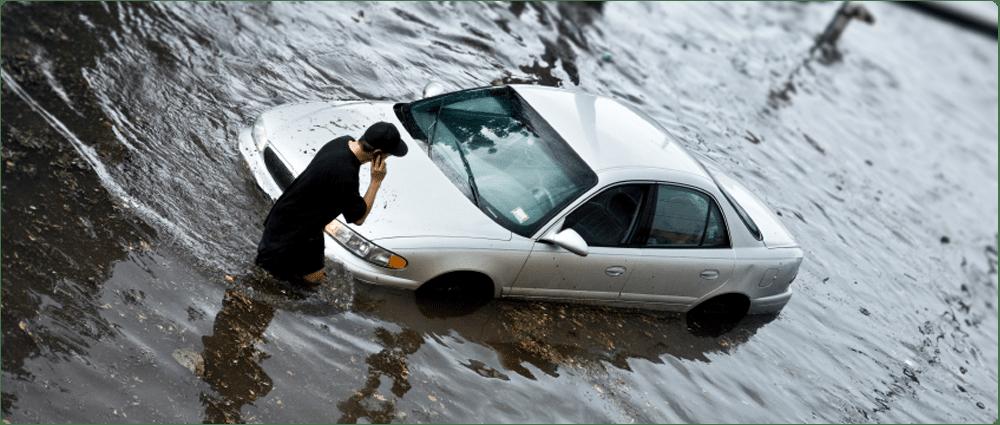 Car stuck in flooded street