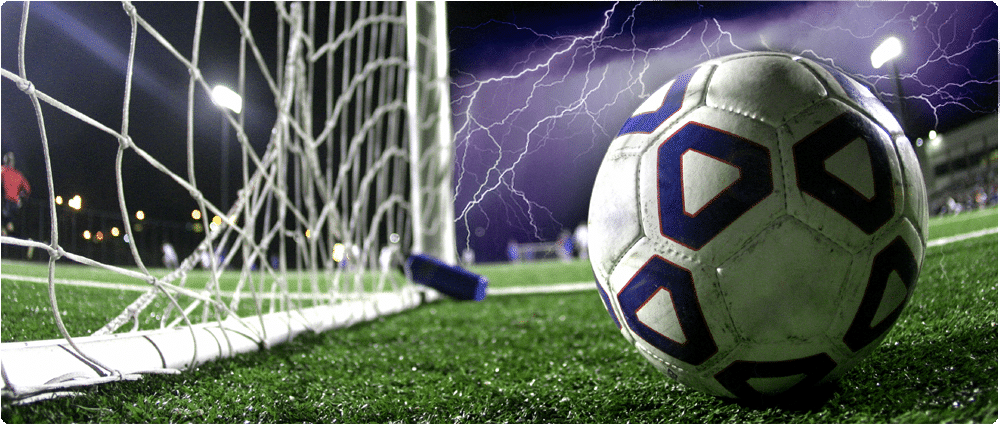 Soccer ball with lightning in background